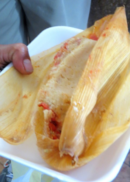Delicious chicken and red chile tamal, Photo credit: Lola's Cocina
