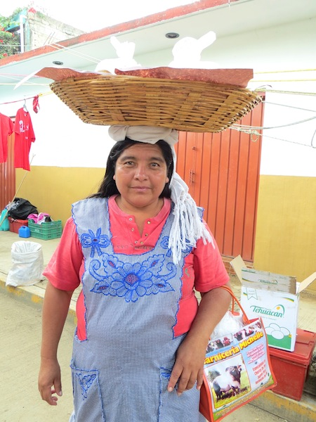 Common Sight at Mercados - Women Carrying Baskets on Their Heads, Photo Credit: Lola's Cocina